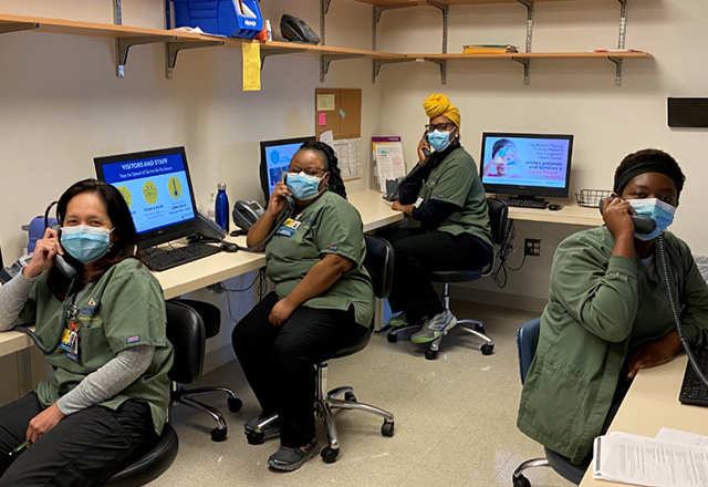 Call center employees at the Johns Hopkins Hospital pose for a photo during the COVID-19 pandemic