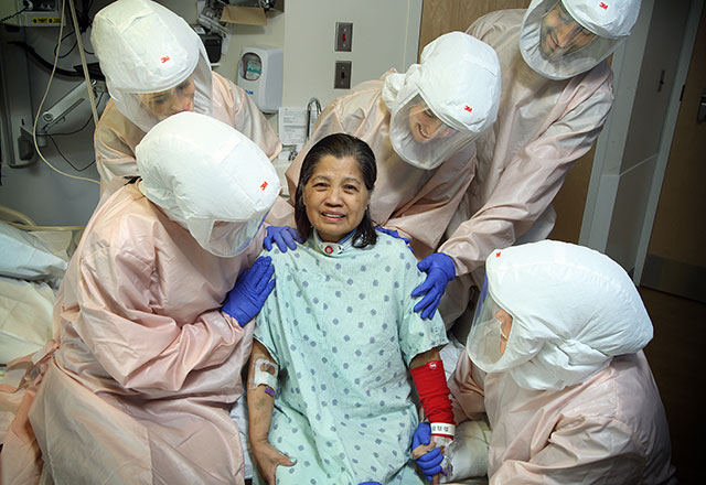 COVID-19 patient surrounded by her care team