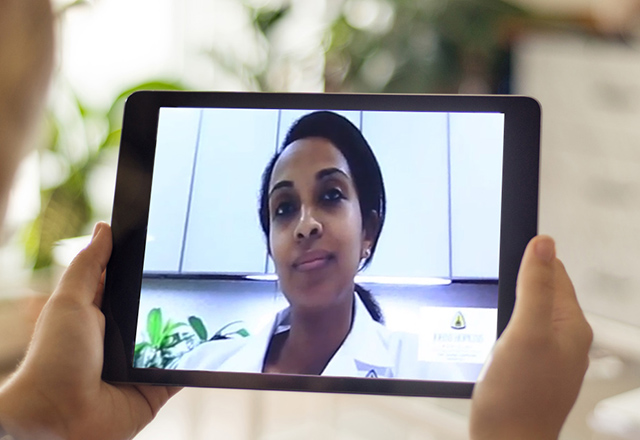 telemedicine with doctor on tablet