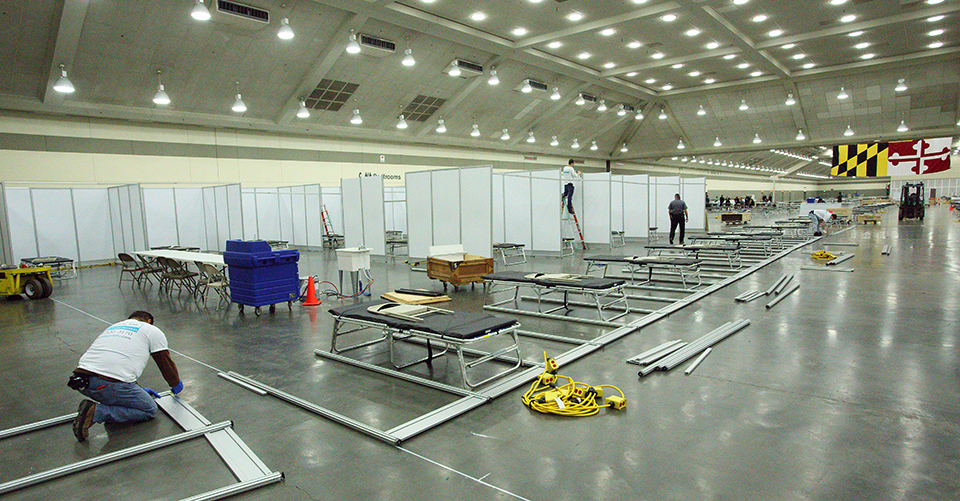 Person working on construction in the Baltimore Convention Center Field Hospital.