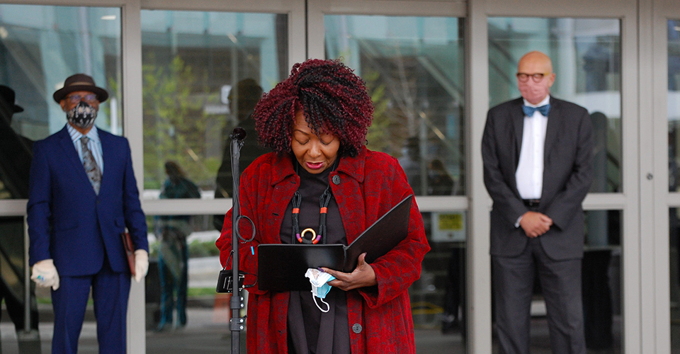 Hickman saying a prayer outside the Baltimore Convention Center Field Hospital.