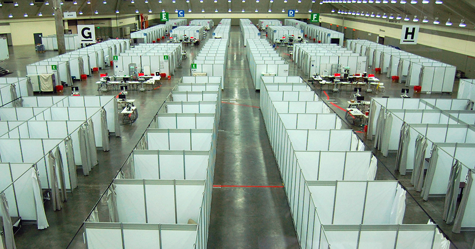 Rows of cubicles inside the Baltimore Convention Center Field Hospital.