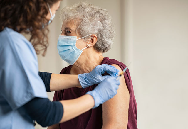 A community member asks question to a nurse prior to receiving a COVID-19 vaccine