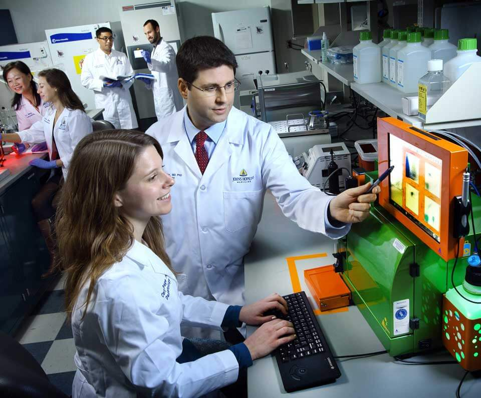 students working alongside world-class physicians and researchers