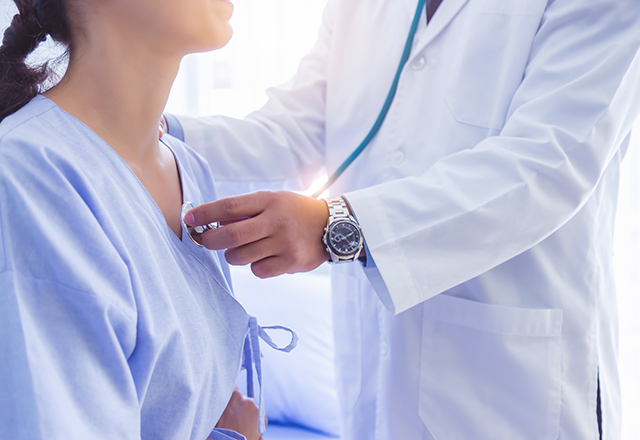 vascular medicine - doctor using stethoscope on patient chest