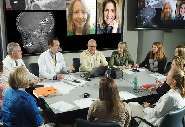 Johns Hopkins Cochlear Implant Specialists in a conference room