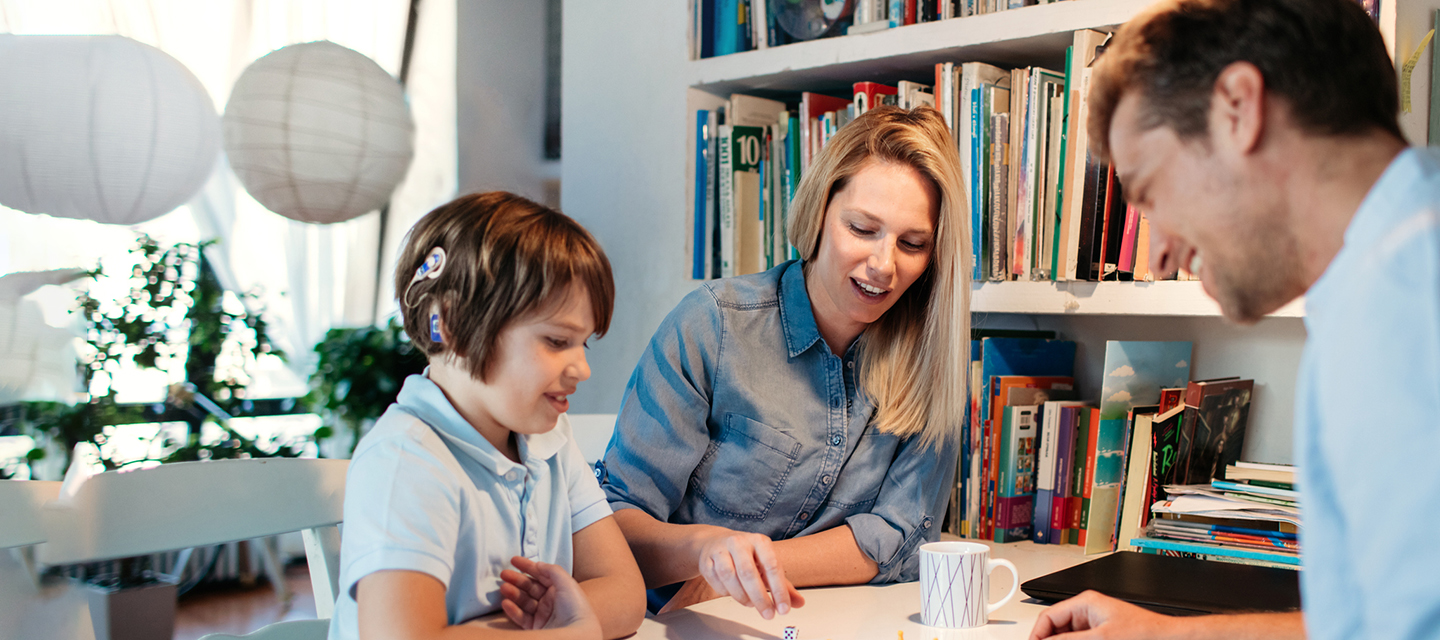 parent and child with cochlear implant