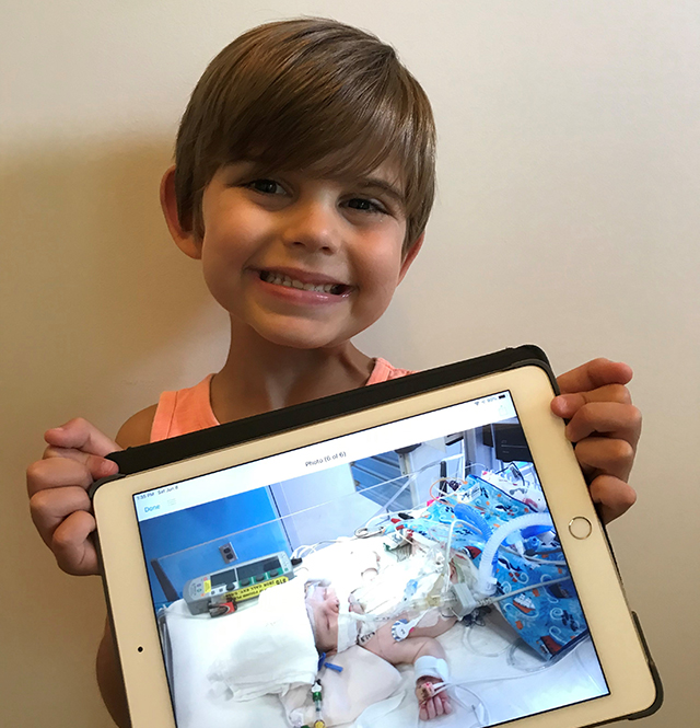 pediatric and congenital heart center - image of Carter Bley holding tablet