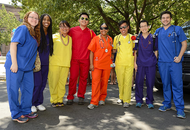 A group of nurses in rainbow scrubs