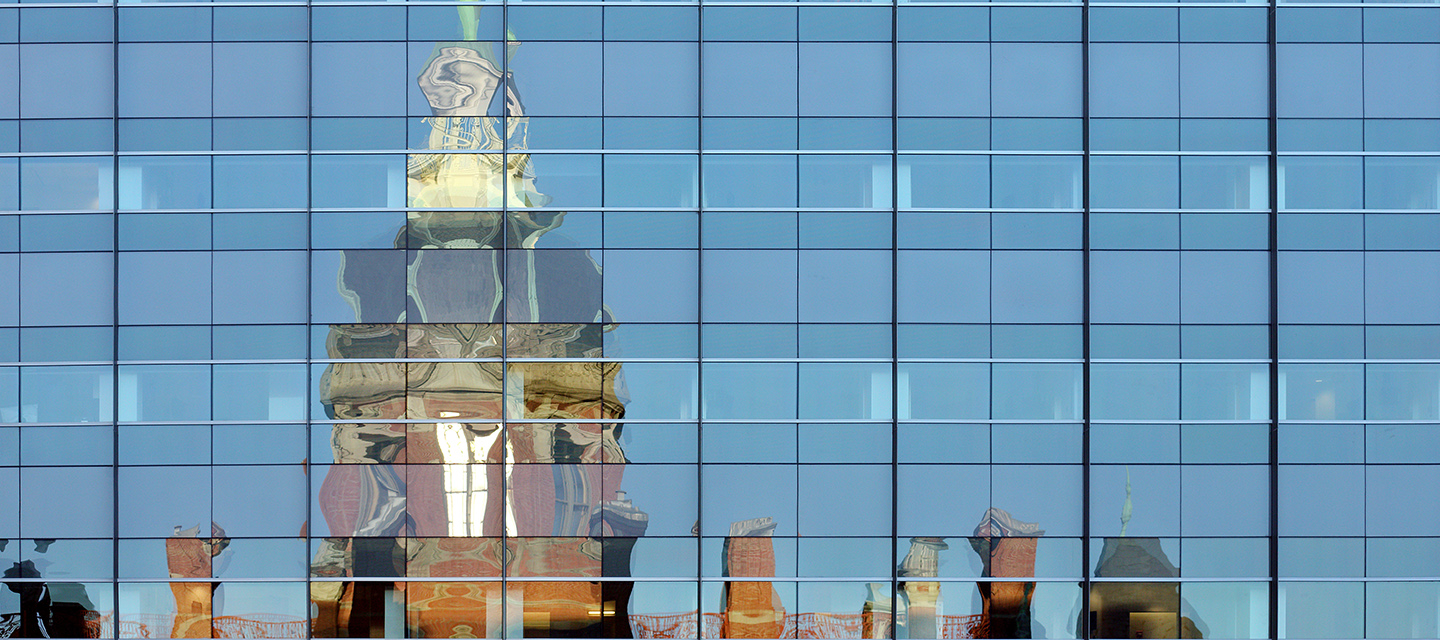 The Dome reflected in the windows of the Nelson-Harvey building.