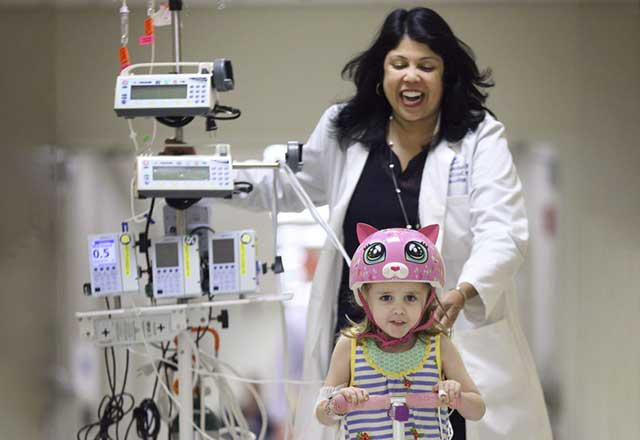 Pediatric provider walking with patient