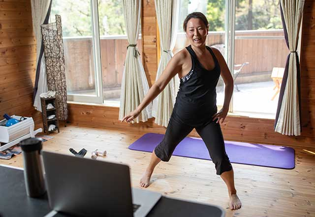 Woman doing an aerobic workout at home