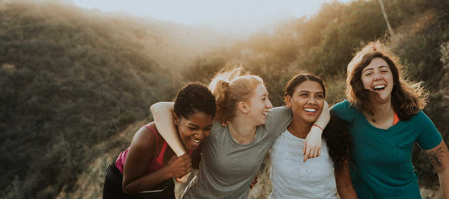 Group of diverse, young women on a rooftop