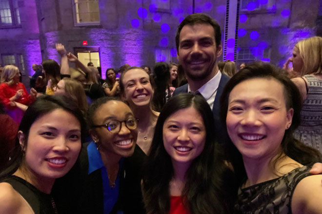 Gyn/Ob residents take a selfie while at a formal event.