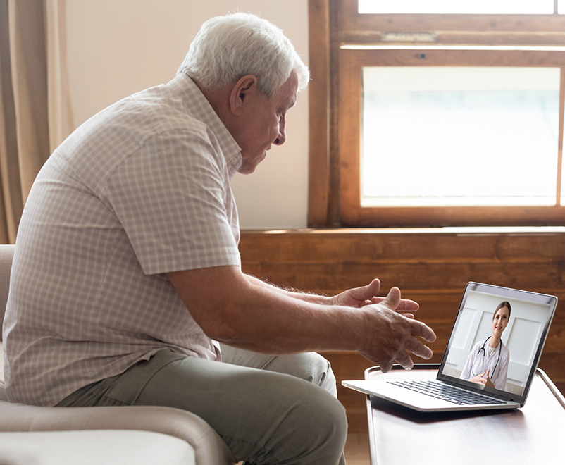 mature man using laptop for telemedicine call - heart and vascular