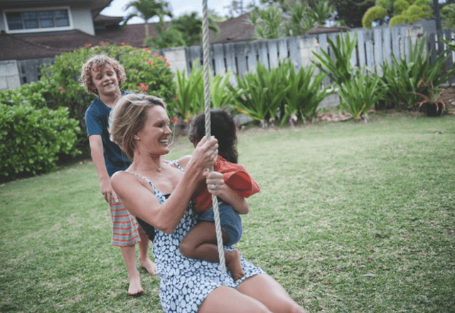heart and vascular institute - image of Gina on swing with her children