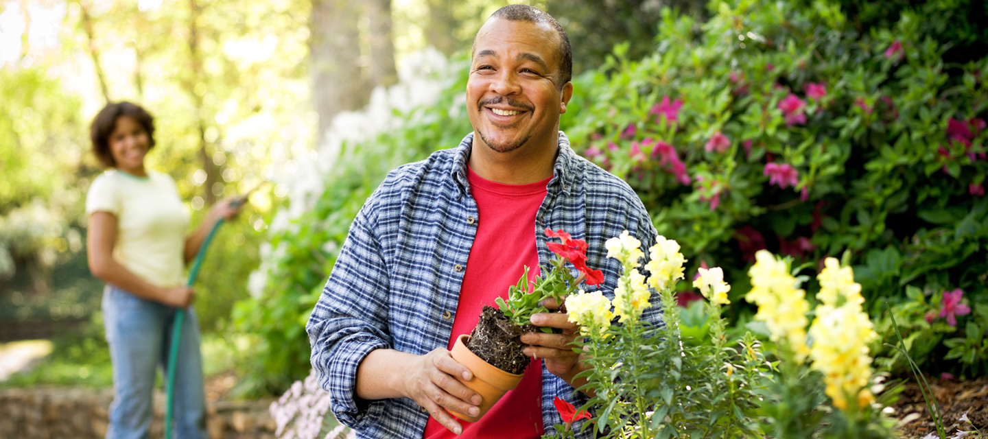 ventricular assist devices - man holding plant smiling