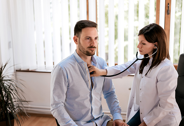 cardiac sarcoidosis - doctor listening to male patient's chest