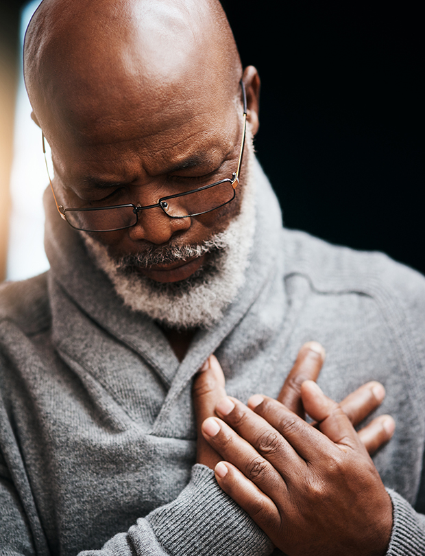 african american man holding chest in pain