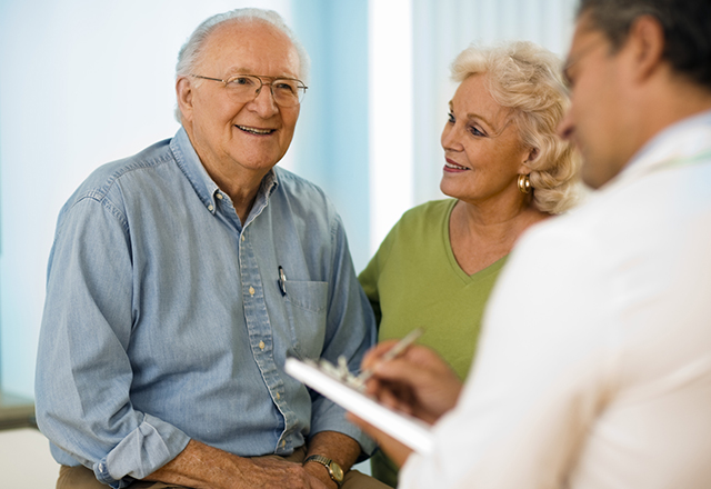 male patient with spouse talking to doctor
