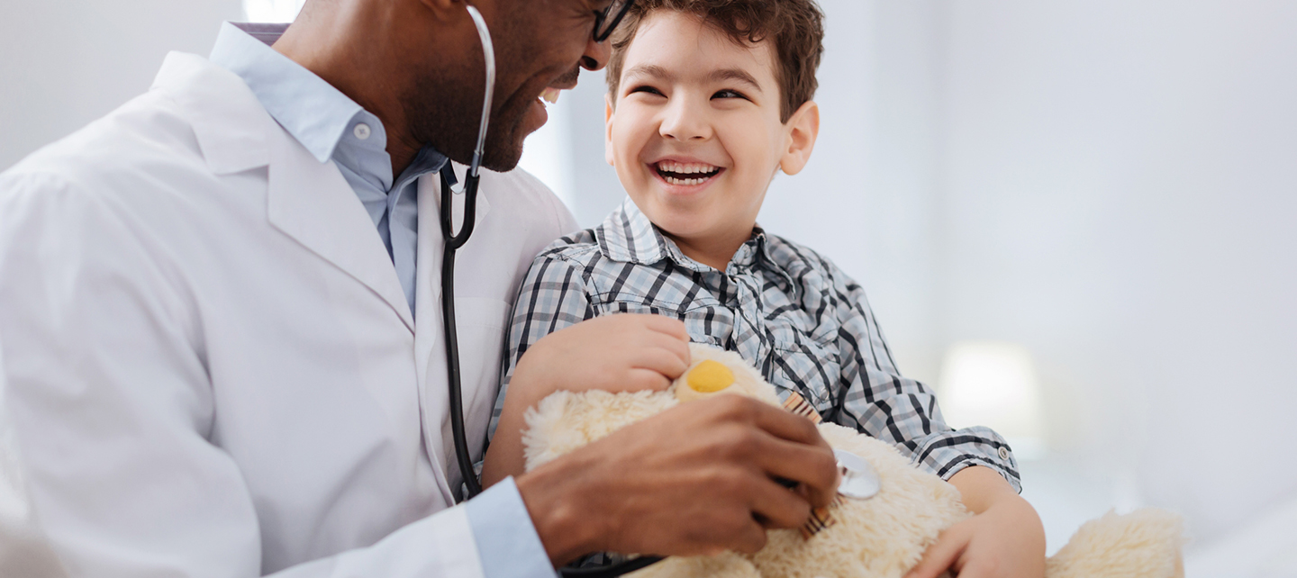 doctor listening to a boy's heart