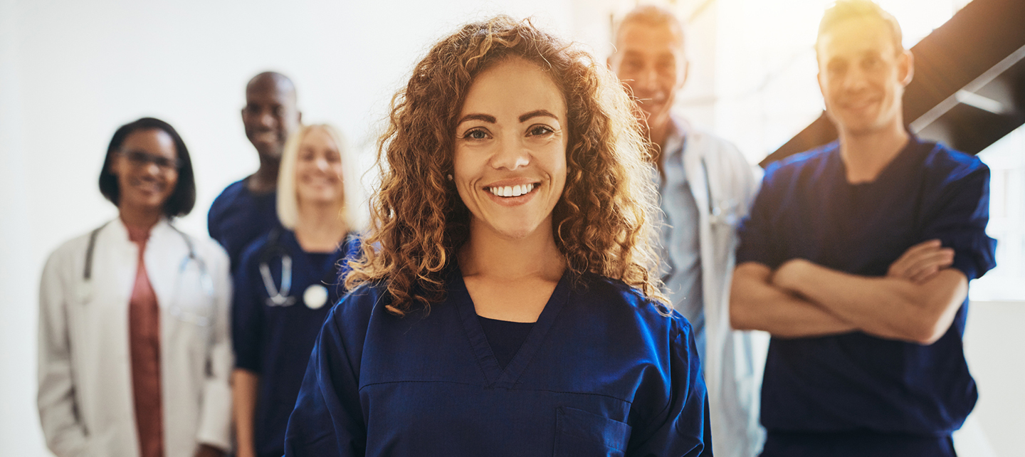 woman standing out among doctors - cardiovascular training and fellowships