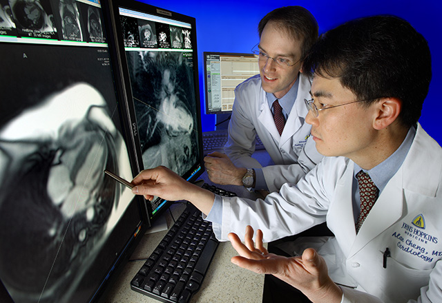doctors looking at image on computer - cardiology fellowship program