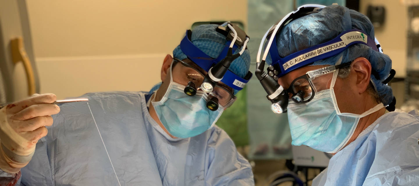 Drs. Abularrage and Strosberg operating - vascular surgery and endovascular therapy fellowship