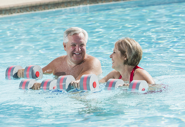 heart and vascular - mature couple doing aerobic exercise in pool