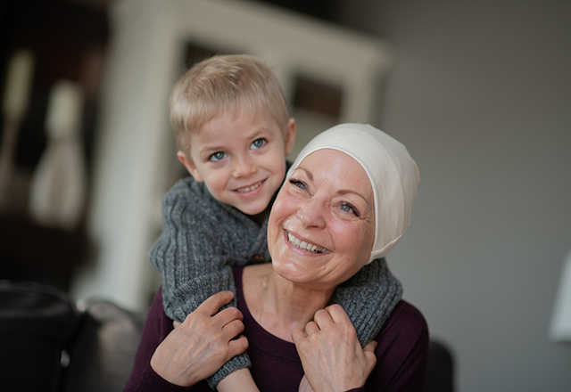 heart and vascular - woman wearing scarf smiling with grandson