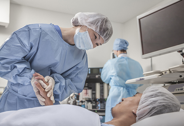 surgeon holding patient's hand