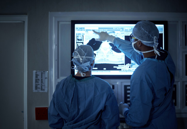 surgeons observing xray in or - heart and vascular institute