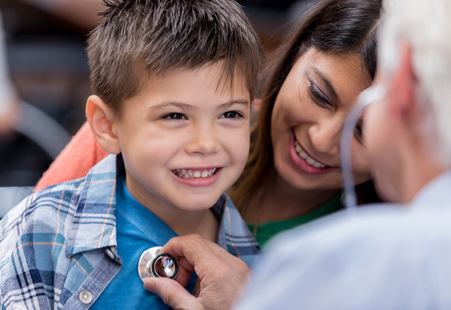 boy smiling at doctor - heart and vascular institute