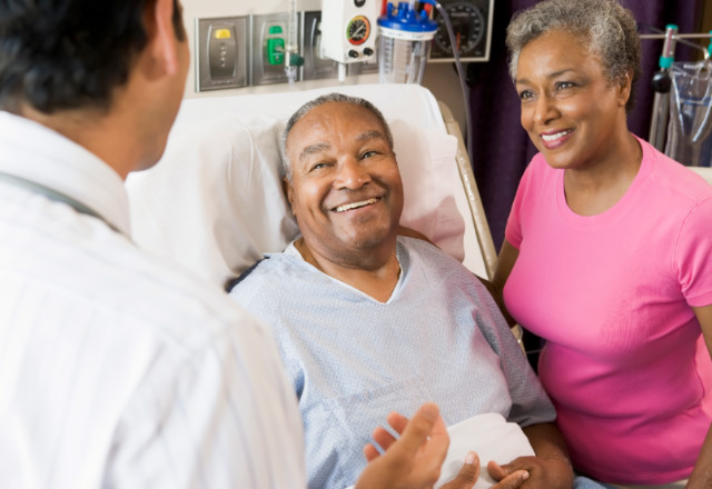 doctor explaining to patient and family - heart and vascular institute