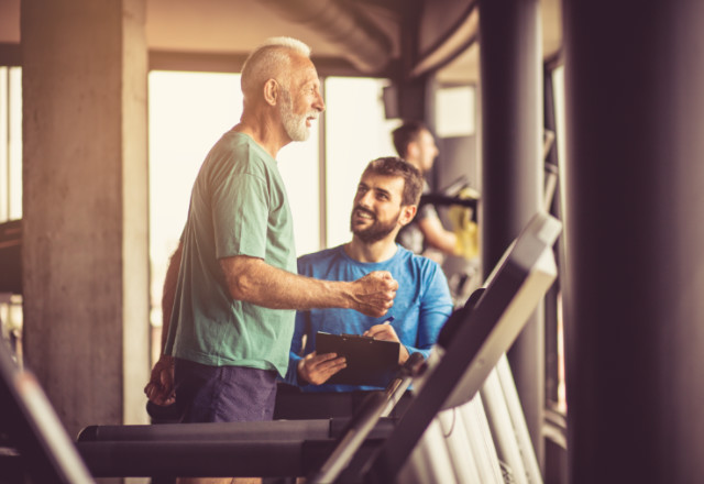doctor helping patient work out - cardiac rehabilitation