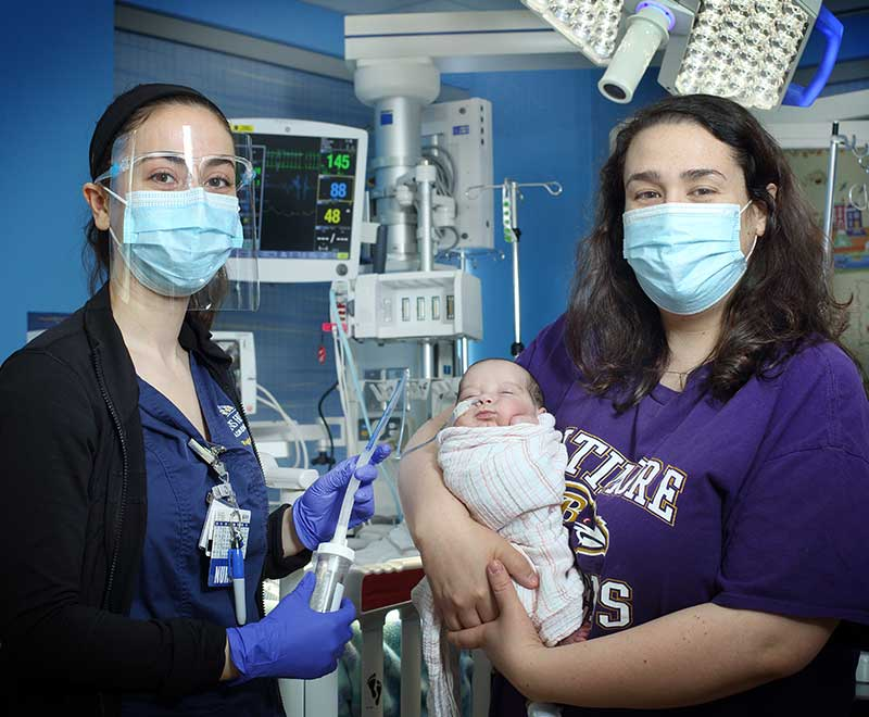 A nurse with a mother and baby
