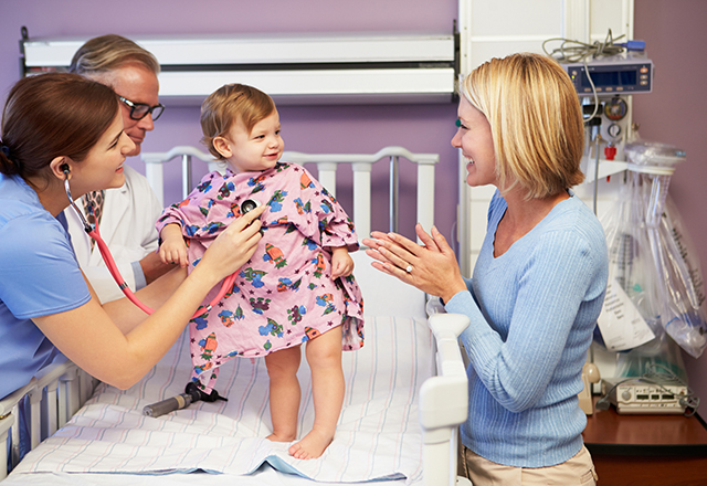 toddler girl standing in hospital bed - pediatric and congenital heart center