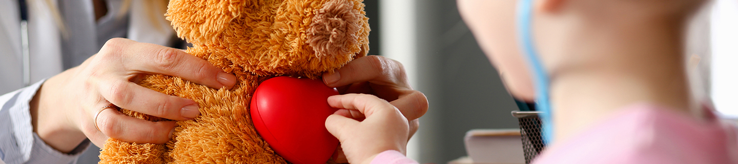 girl using stethoscope on teddy bear - pediatric cardiac surgery