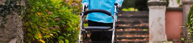 Woman outside using walker