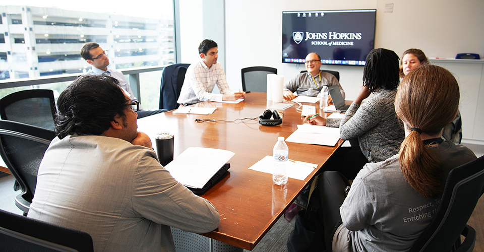 Attendees in a conference room