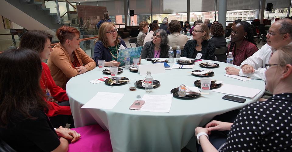 attendees chat over lunch during conference