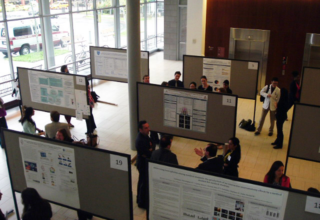 attendees looking at posters