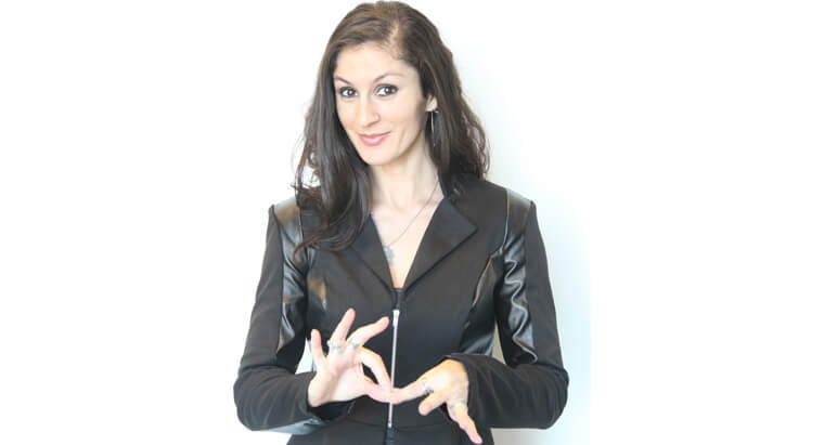 Woman signing a word with Sign Language.