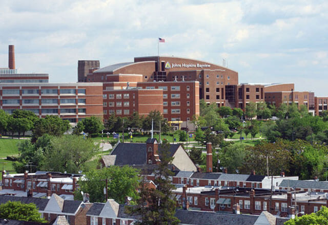 Image of Johns Hopkins Bayview campus and greektown in the distance