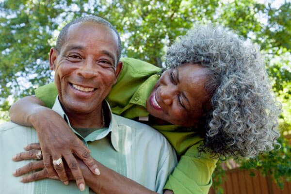 Older African American couple embrassing