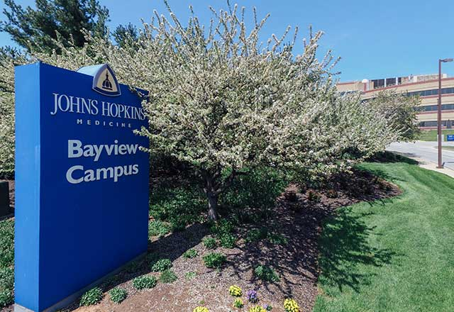 Bayview Campus sign in front of a parking garage