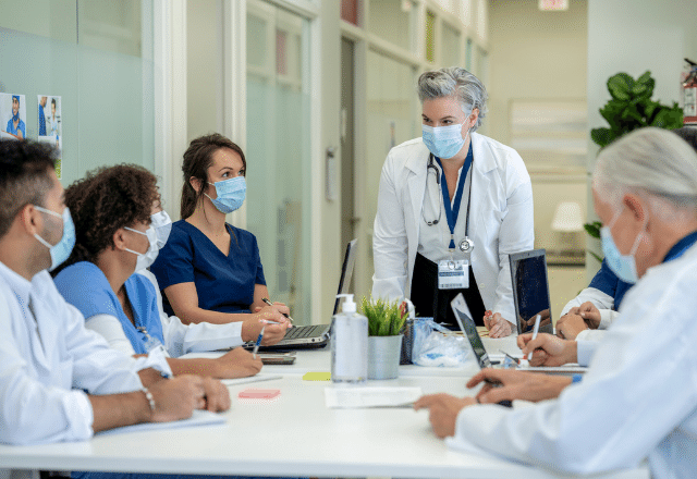 healthcare providers sitting around a table in a meeting