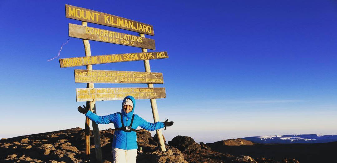 Gillian Lichota at the top of Mt. Kilimanjaro.