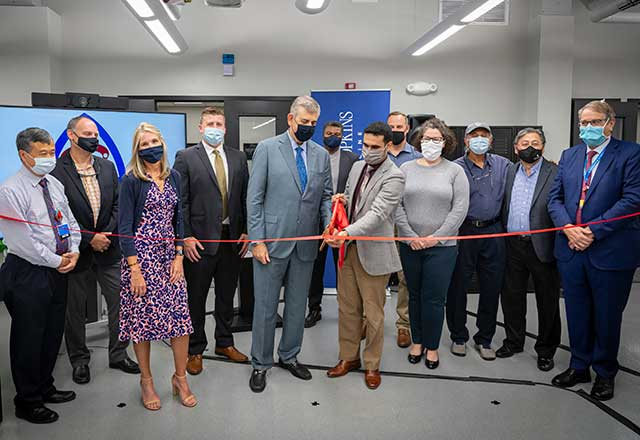 Team members at a ribbon cutting ceremony