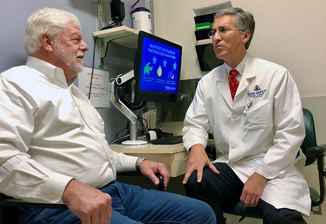 Dr. Maragakis speaking with a patient